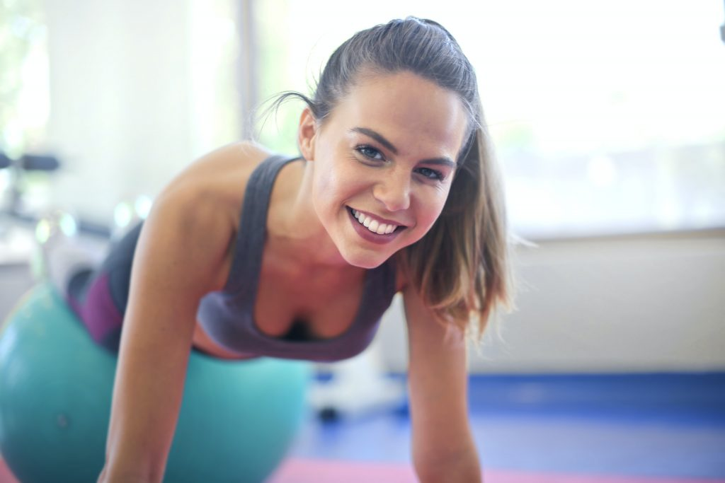 Mental Health Benefits of Pilates - woman smiling