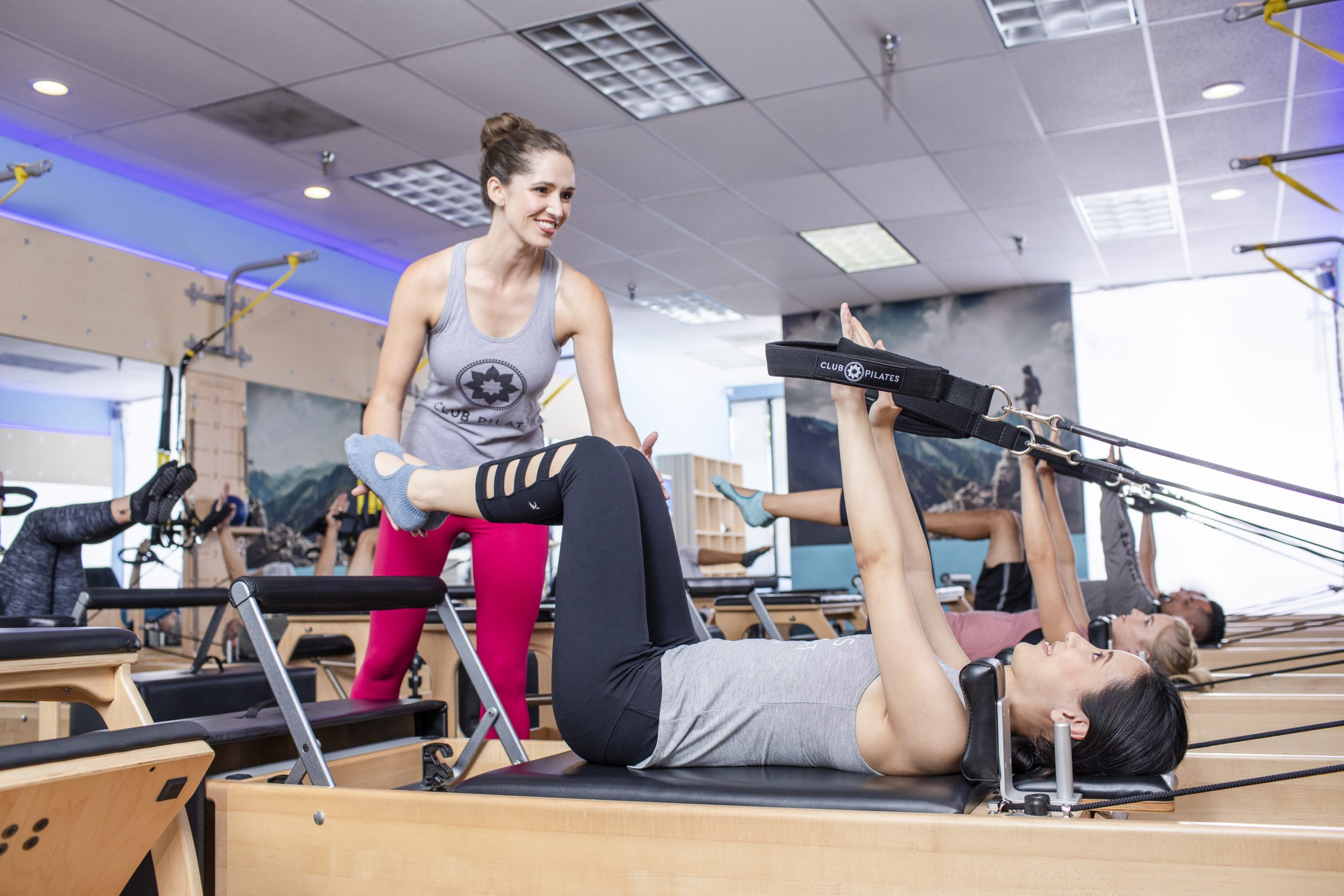 Pilates VS Yoga: Which is Best for You? - women doing Pilates on reformer